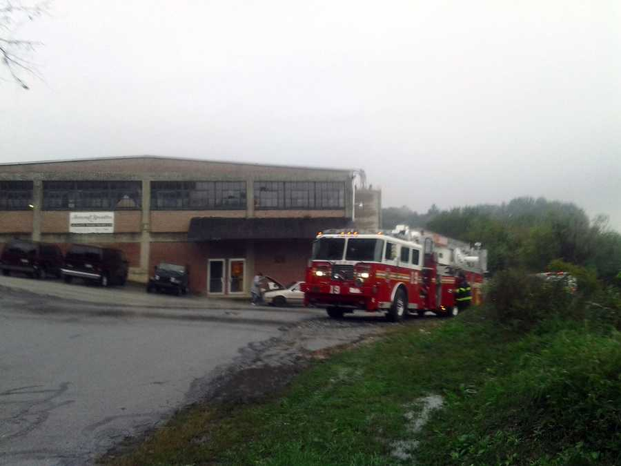 Crews remain at the scene of a silo fire at a Red Lion wood furniture company.