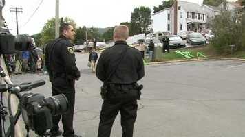 Police wait for Sandusky before his arrival.
