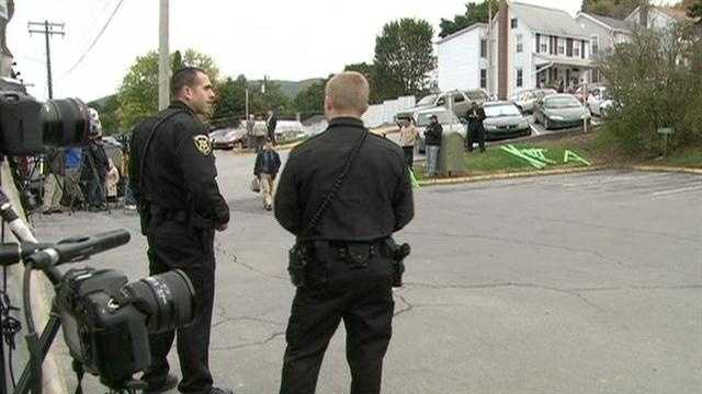 Police wait for Sandusky before his arrival.