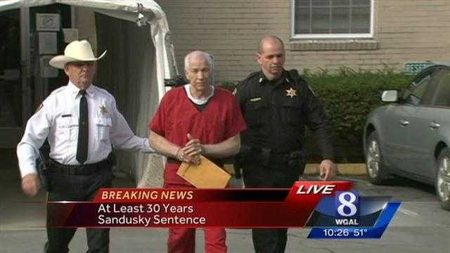 Jerry Sandusky leaves court after being sentenced on Oct. 9.