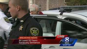 Sandusky is put into a waiting police car. He'll spend the next 10 days at the Centre County Prison. Then he will go to Camp Hill to be evaluated and processed before being assigned to another prison.