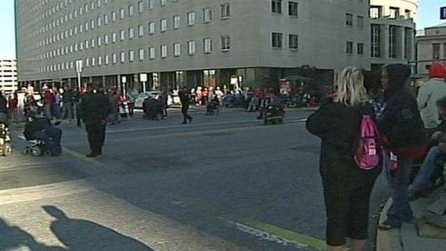 Some demonstrators at the state Capitol face charges after police said they blocked Commonwealth Avenue and Forster Street near the state Department of Welfare Tuesday.