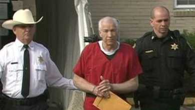 Jerry Sandusky leaves court after being sentenced on Oct. 9, 2012.