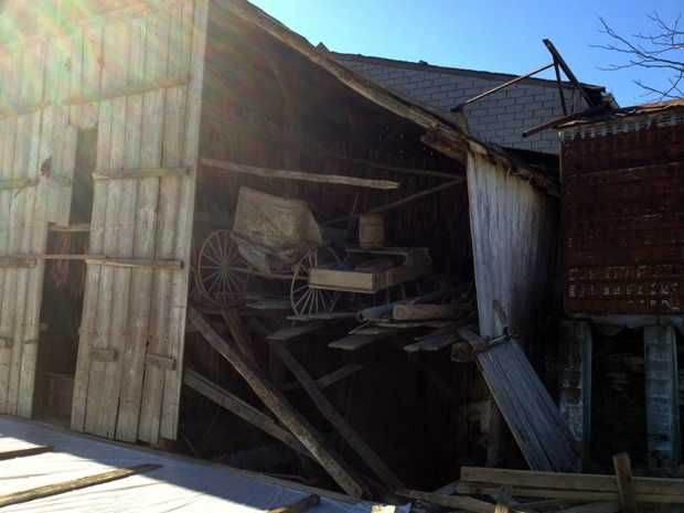 An Amish courting buggy hangs out the back of a damaged barn. Fisher said this was the buggy he used when he was courting his wife.