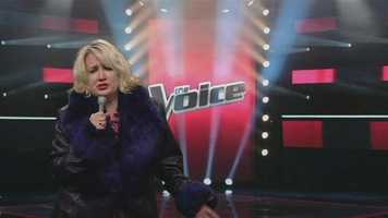 """Football Friday producer Rhonda Keiser does an impression of a contestant on """"The Voice"""" while singing """"Proud Mary."""""""