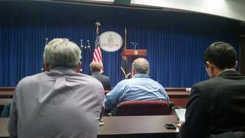 Reporters wait for Attorney General Linda Kelly's news conference.
