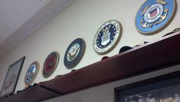 One of the walls in his office is devoted to the Armed Forces. Platts served on Committee on Armed Services.