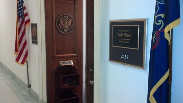 """The Pennsylvania state flag and a U.S. flag hang outside the door of Platts' fourth-floor office. A sign hangs outside his office, as it does every representative's office, that reads, """"Please, come in."""""""