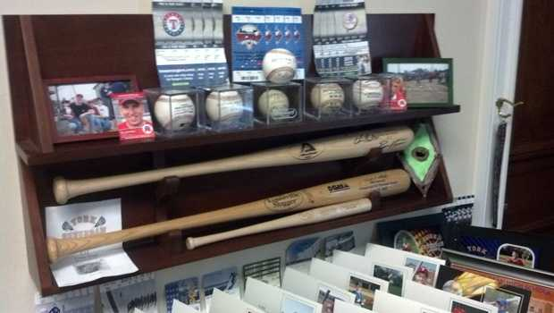 Platts and his family are big sports fan. Sports memorabilia fills much of his office.