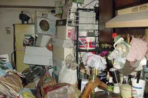 """The International OCD Foundationdefines hoarding as """"a complex disorder thatis made upof threeconnected problems: 1) collecting too many items, 2) difficulty getting rid of items, and 3) problems with organization."""""""