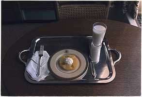 This was President Richard M. Nixon's last meal in the White House. A glass of wholesome milk, pineapple and what looks to be cottage cheese were served up on a silver platter. The year was 1974.