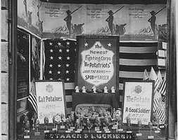 """This store display, from 1917-1918, promotes potatos as """"potatriots."""" Part of the display says, """"The potato is a good soldier. Eat it uniform and all."""""""