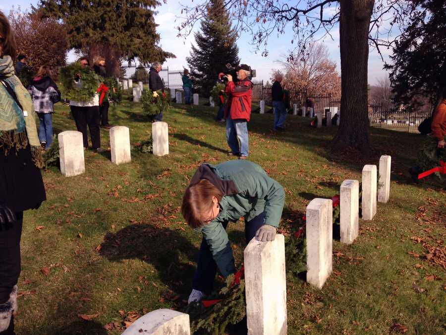 Volunteers placed 1,600 wreaths on veterans' graves at Gettysburg National Cemetery on Friday.