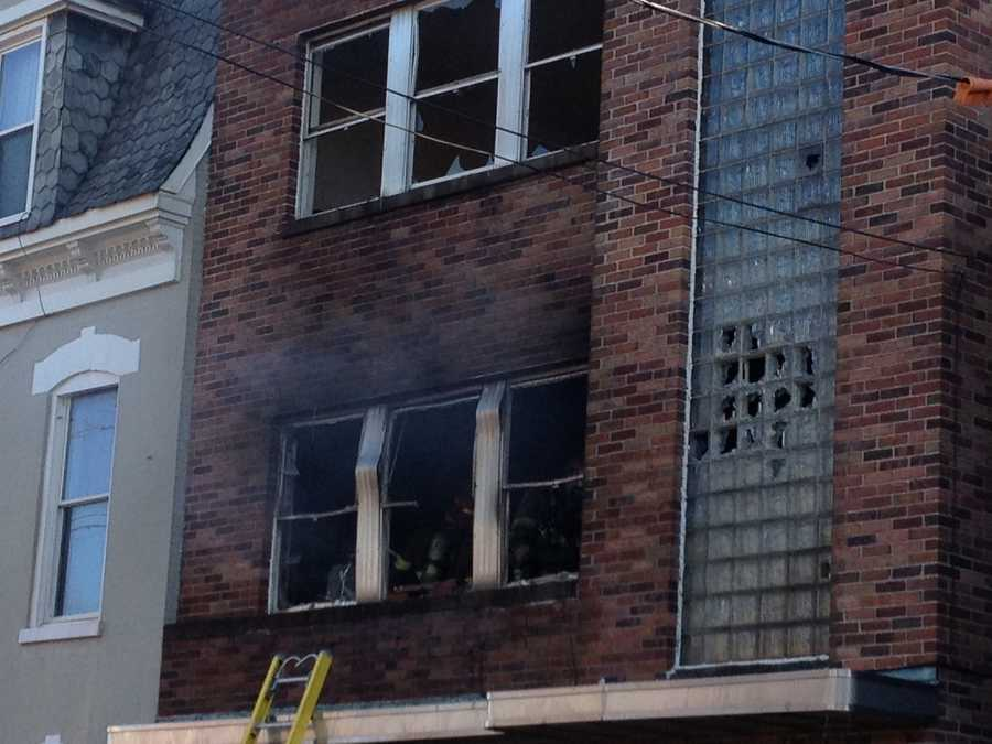 The fire started on the second floor of an abandoned brick building around 1:30 p.m.