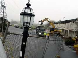 Crews used heavy machinery Monday morning to begin tearing down the nearly 50-year-old building.