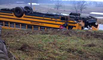 A pickup truck collided head-on with a school bus, flipping the vehicle with 30 children on board onto its roof along an Adams County road on Friday afternoon.
