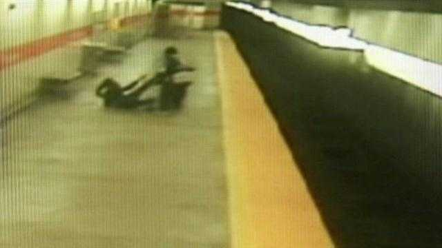 This surveillance image shows the woman being dragged on the subway platform.