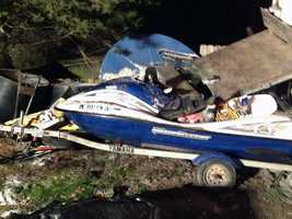 A snowmobile and jet ski parked near the home as well as the residence were damaged.