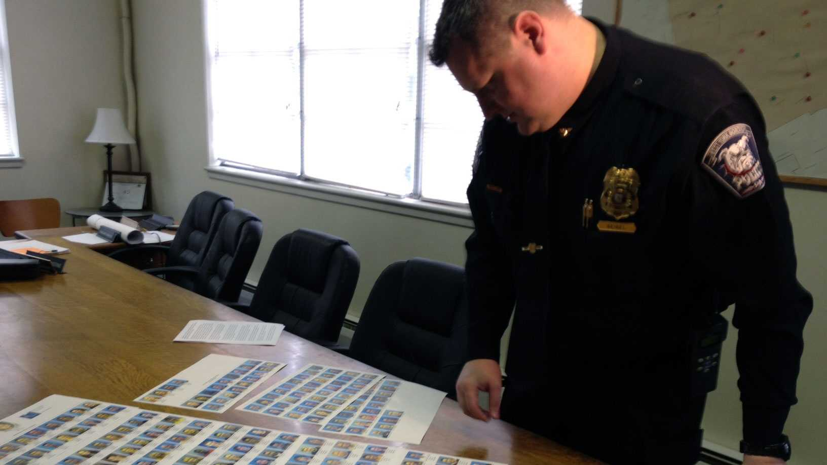 The West York police chief looks at photos of the retail theft suspects.