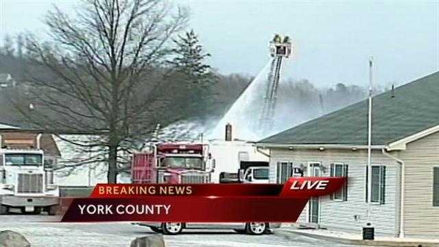 Crews battled a fire after an explosion ripped through a business in Carroll Township, York County, on Thursday afternoon.
