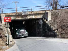 The tractor trailer got stuck under a Norfolk Southern bridge on Woodland View Drive near Black Ridge Road.