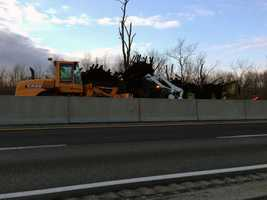 A front end loader and a Bobcat remove tires from the tractor trailer that caught fire.