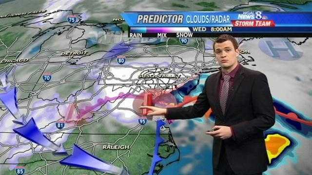8 a.m. Wednesday -- Light white indicates CLOUDS. Bright white and purple indicate SNOW. Pink indicates WINTRY MIX. Blue, green, orange and yellow indicate RAIN.