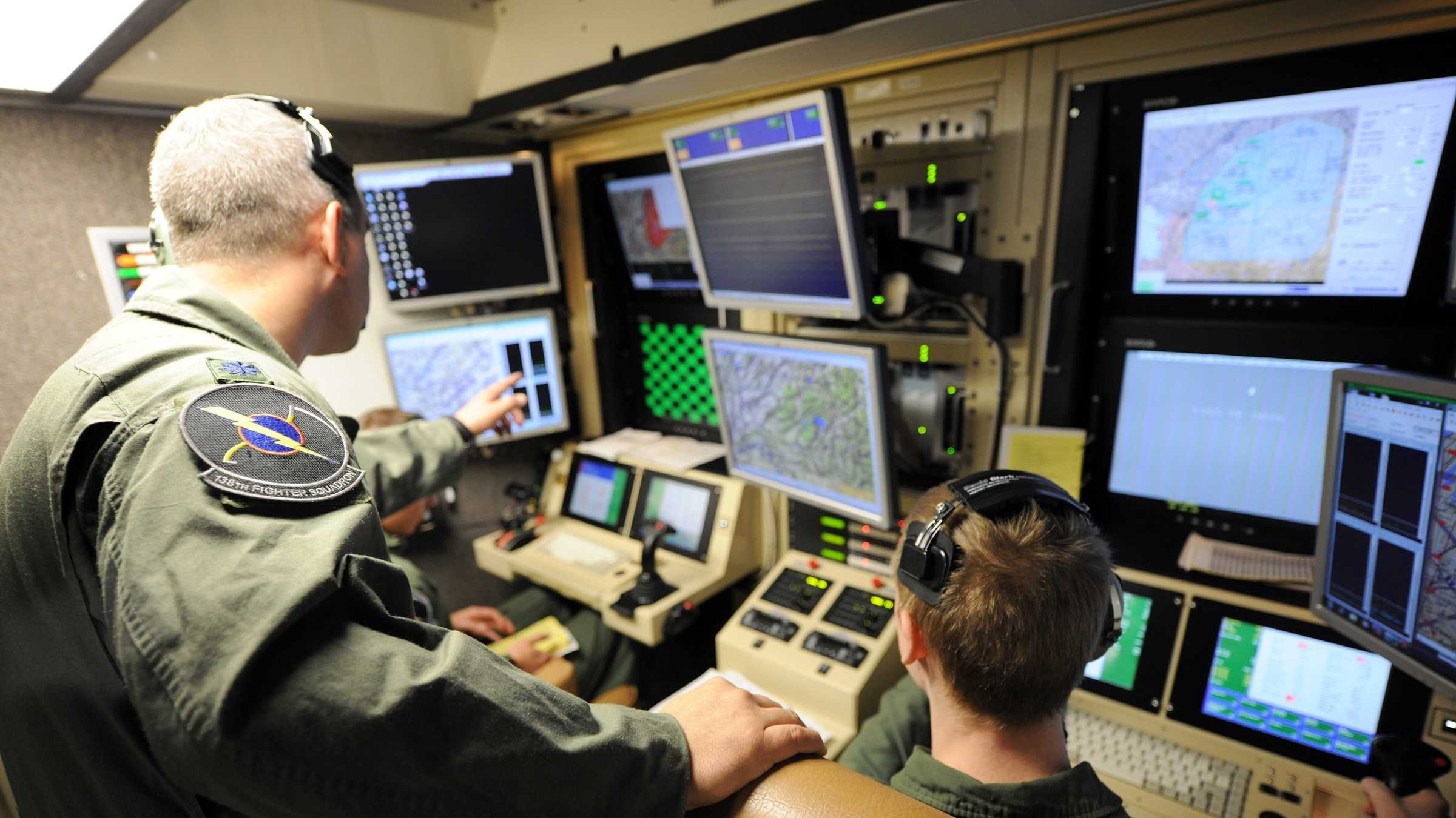 A student pilot and sensor operator man the controls of an MQ-9 Reaper in a ground-based cockpit during a training mission flown from Hancock Field Air National Guard Base, N.Y.
