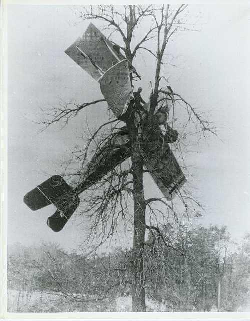 Things did not always go as planned. This photo shows stunt pilot Howard Casterline who crashed his Jenny into a tree in Hartford City, Indiana. He survived the crash.