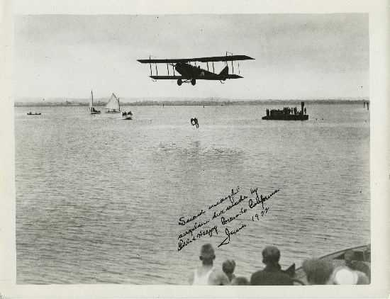 Some stunt men and women would even dive off moving planes into water. Here, stunt man Eddie Hergoy successfully completes an airplane dive.