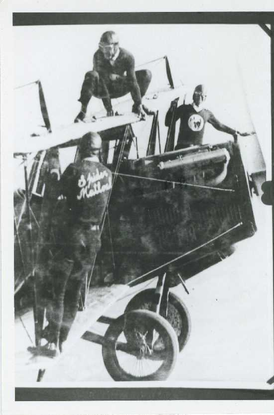 This photo shows members of the Black Cats in mid-air getting ready to perform a stunt.