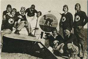 One of the most famous groups of barnstormers was the Hollywood Black Cats. Here 9 members of the group pose next to their stunt plane.