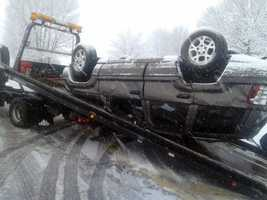 The SUV flipped over.