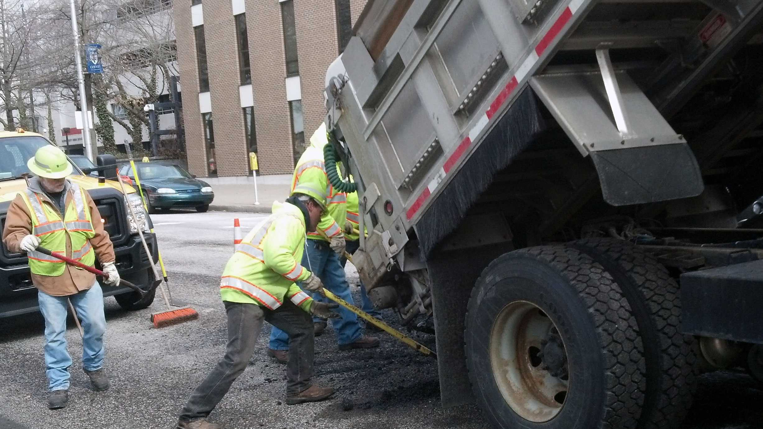 A pothole crew works on Front Street near Chestnut Street in Harrisburg.