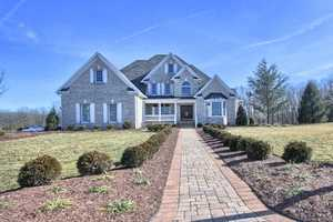 Take a tour of this amazing six bedroom, five bathroom home with a huge yard and deck perfect for entertaining guests. The home is on the market for $1.095M and is featured on realtor.com