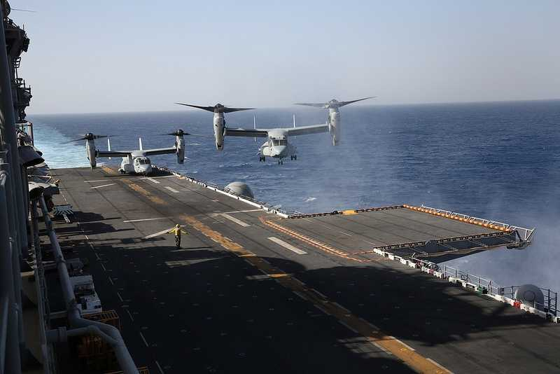 An MV-22 Osprey lands aboard USS Kearsarge at sea.