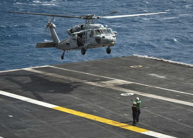 An MH-60S Sea Hawk helicopter assigned to the Indians of Helicopter Sea Combat Squadron (HCS) 6 takes off from the flight deck of the aircraft carrier USS Nimitz .