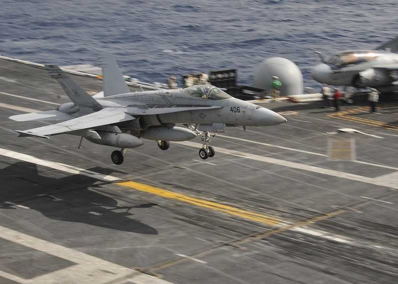 An F/A-18C Super Hornet assigned to the Death Rattlers of Marine Fighter Attack Squadron (VMFA) 323 lands on the flight deck of the aircraft carrier USS Nimitz in the Pacific Ocean.
