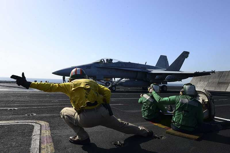 An F/A-18C Hornet assigned to the Rampagers of Strike Fighter Squadron (VFA) 83 launches from the flight deck of the aircraft carrier USS Dwight D. Eisenhower.
