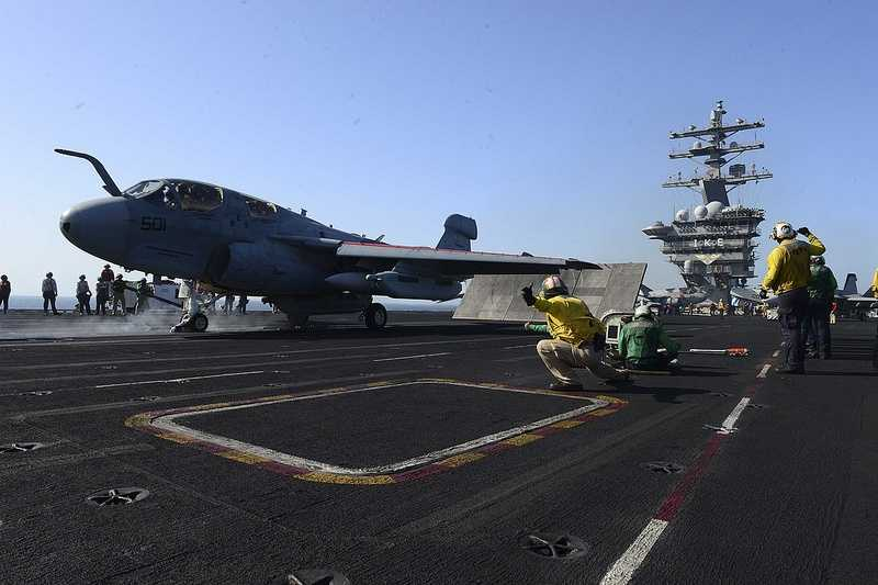 An EA-6B Prowler assigned to the Patriots of Electronic Attack Squadron (VAQ) 140 launches from the flight deck of the aircraft carrier USS Dwight D. Eisenhower.