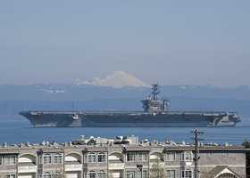 EVERETT, Wash. (March 30, 2013) The aircraft carrier USS Nimitz (CVN 68) passes by Mt. Baker as it departs for a scheduled deployment from its homeport, Naval Station Everett.