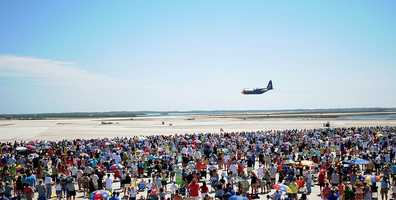 KEY WEST, Fla. (March 23, 2013) Fat Albert, the C-130 Hercules aircraft assigned to the U.S. Navy flight demonstration squadron, the Blue Angels, performs a high-speed flat pass over Boca Chica Field during the 2013 Southernmost Air Spectacular. More than 26,000 people attended the first day of the air show, March 23.