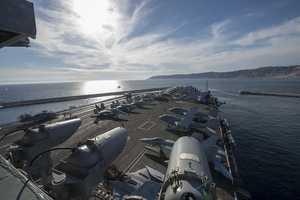 MEDITERRANEAN SEA (March 10, 2013) The Nimitz-class aircraft carrier USS Dwight D. Eisenhower (CVN 69) departs Marseille, France, after a scheduled port visit.