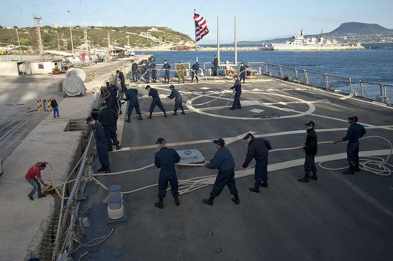 SOUDA BAY, Greece (March 10, 2013) Sailors aboard the guided-missile destroyer USS Barry (DDG 52) prepare to get underway from Souda Bay, Greece, after a port visit.
