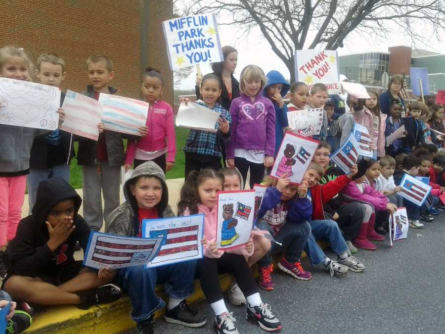 Students in the Governor Mifflin School District lined the street the buses took with flags and signs.
