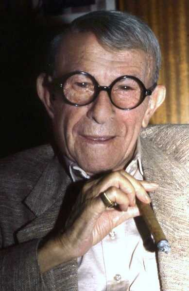 """Happiness is having a large, loving, caring, close-knit family in another city."" George Burns - comedian, actor"