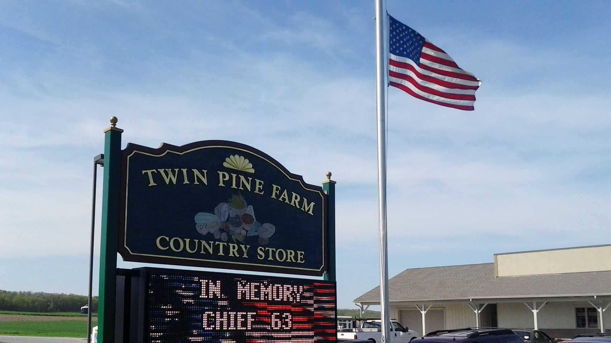 An electronic sign at Twin Pine Farm Country Store honors Loganville Fire Chief Rodney Miller.