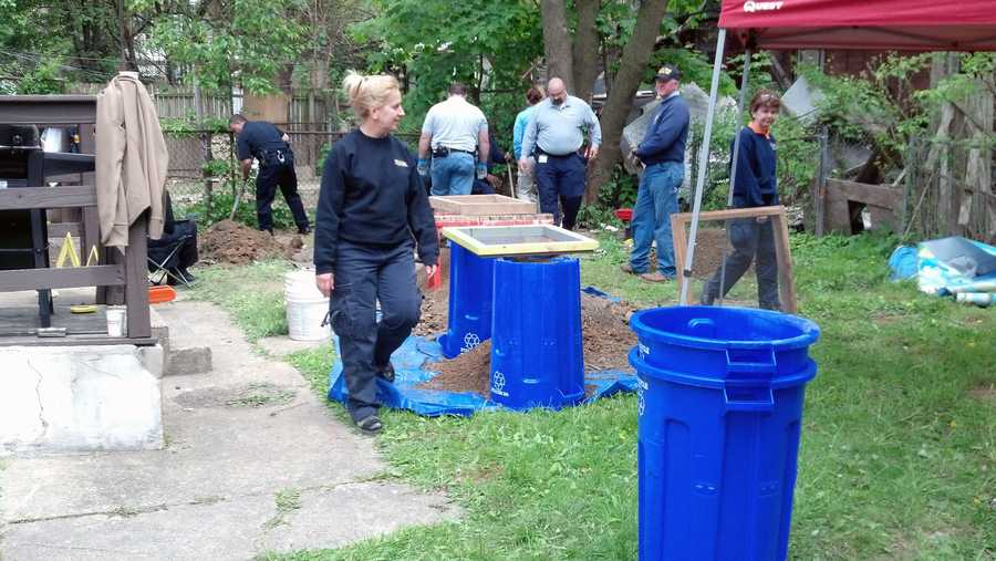 On Monday, investigators began digging in the back yard of a home near 16th and Market streets.
