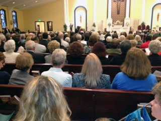 Mourners gather in Holy Name of Jesus Church for Bishop McFadden's funeral.