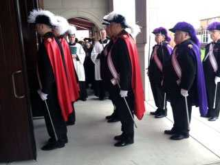 The Knights of Columbus enter the church.